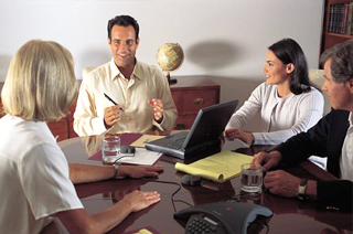 Image of a meeting of a group of people actively and authentically engaged in the conversation