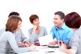 Image of a group of men and women having a business meeting around a table