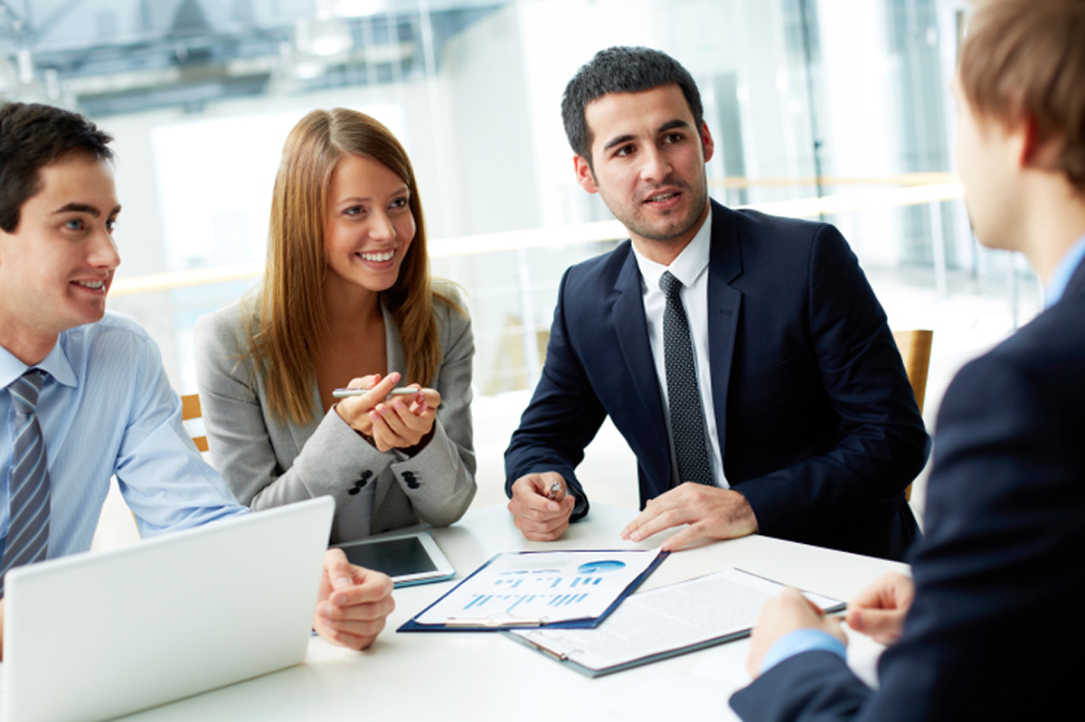 Image of a group of young business people having a consulting meeting