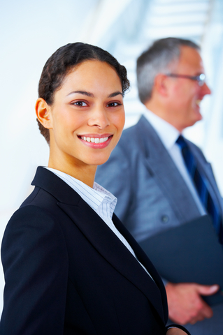 female consultant in suite smiling and looking at camera