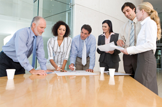 Image of a group of business people making assignments