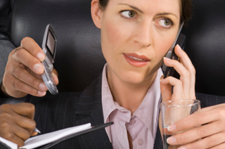 Image of business woman talking on cell photo with hands around her holding glass of water, cell phone, day planner